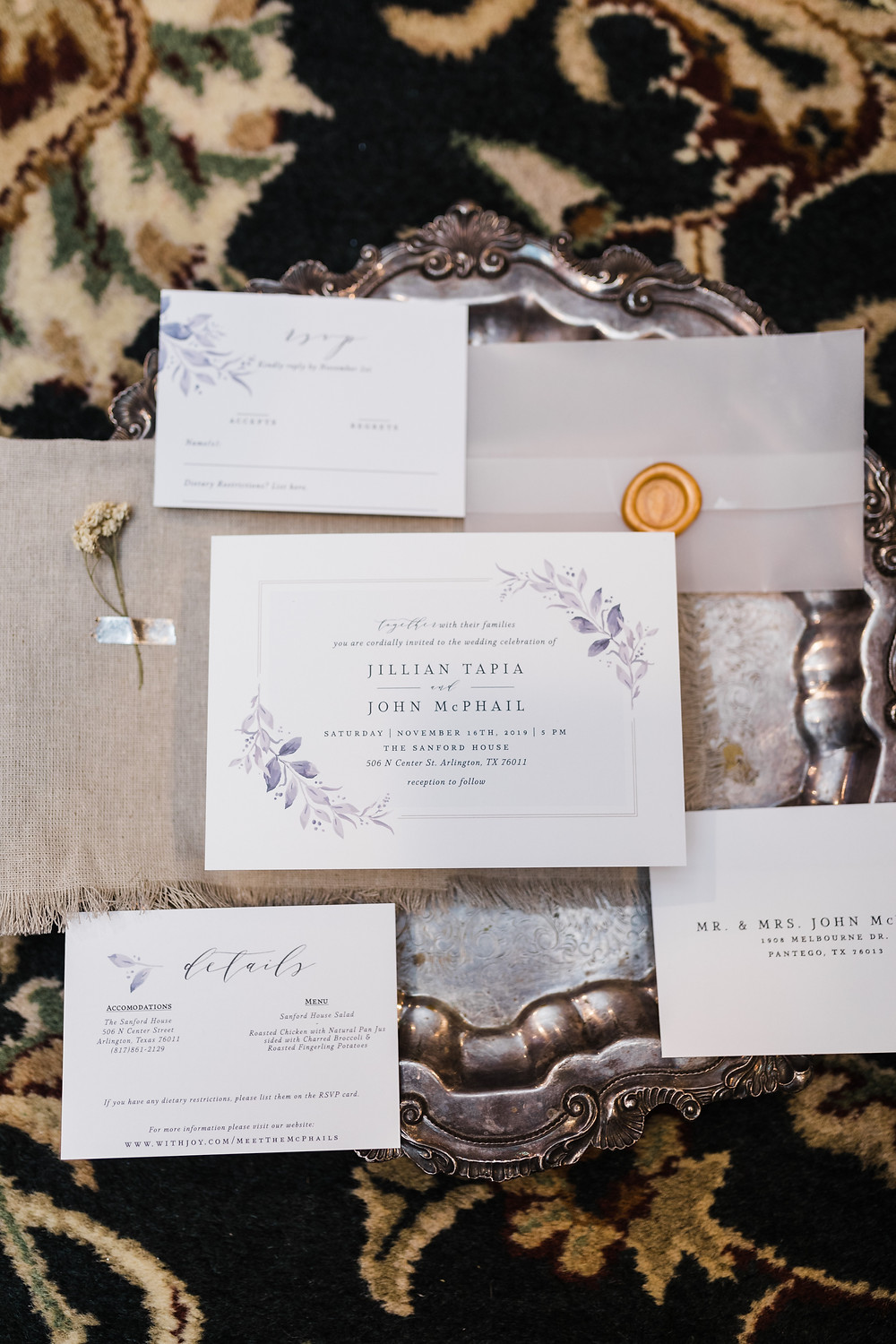 Wedding invitations on a silver platter