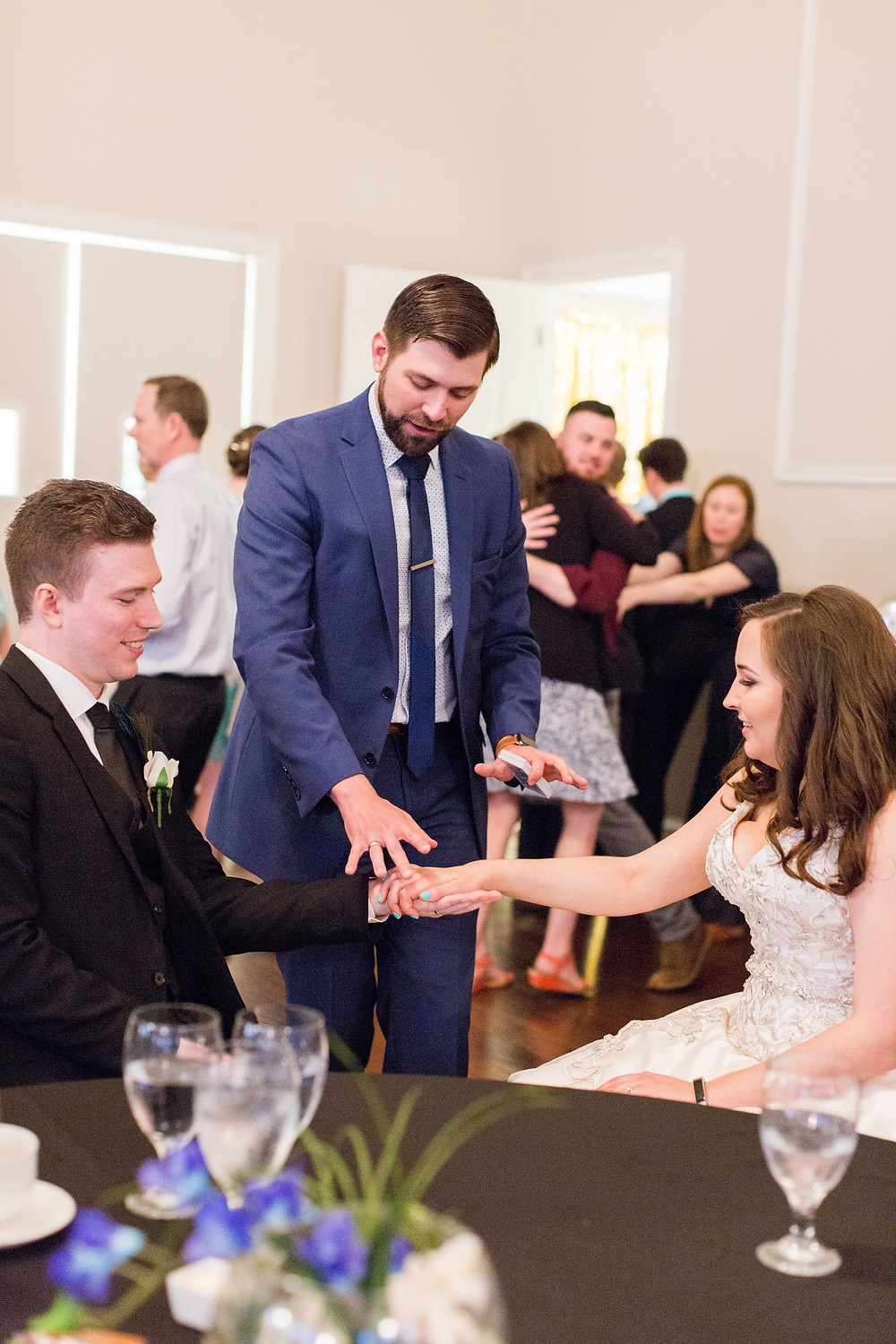 Dallas Magician Anthony Dempsey doing a card trick for a bride and groom.