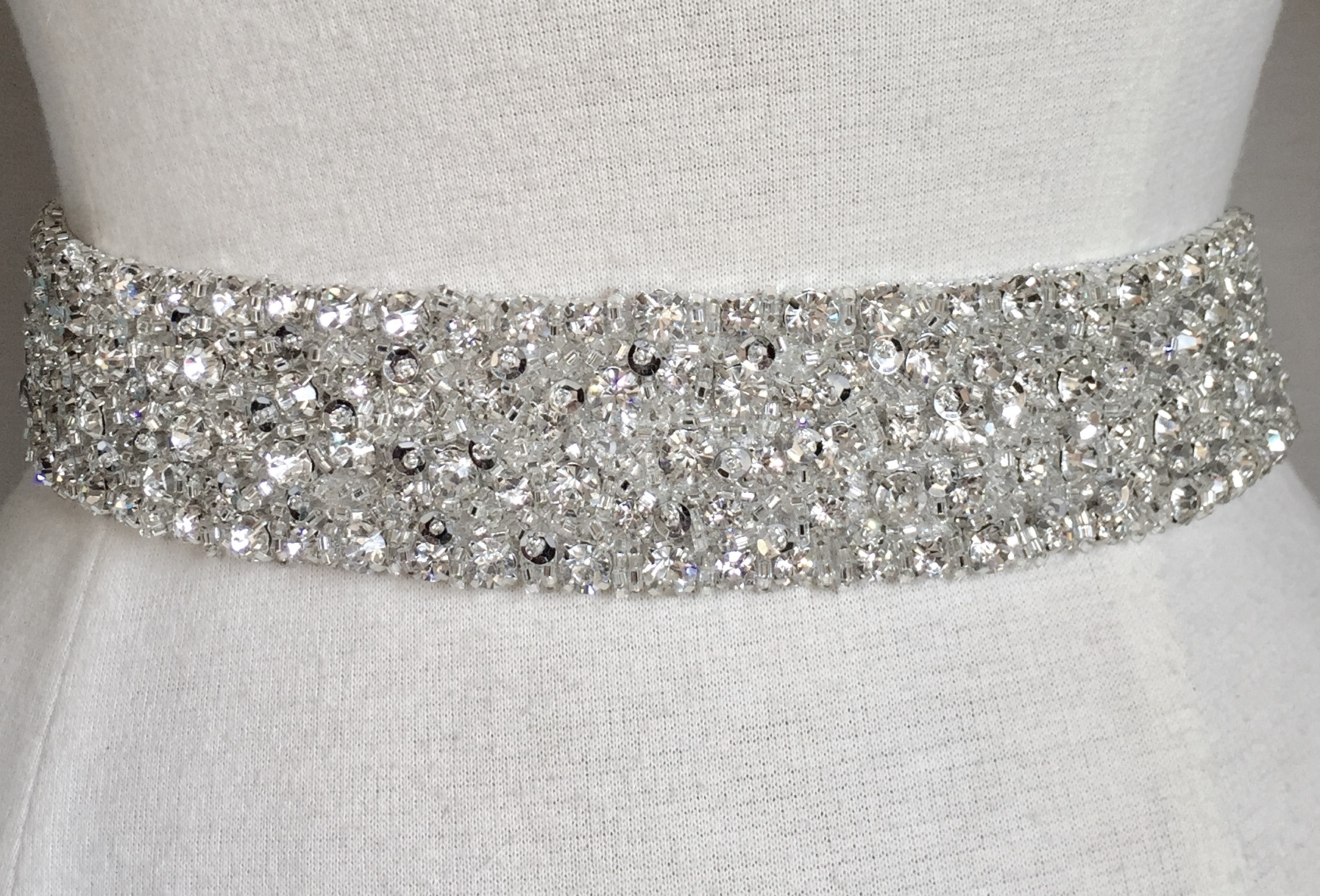 Heavily embroidered silver sash with