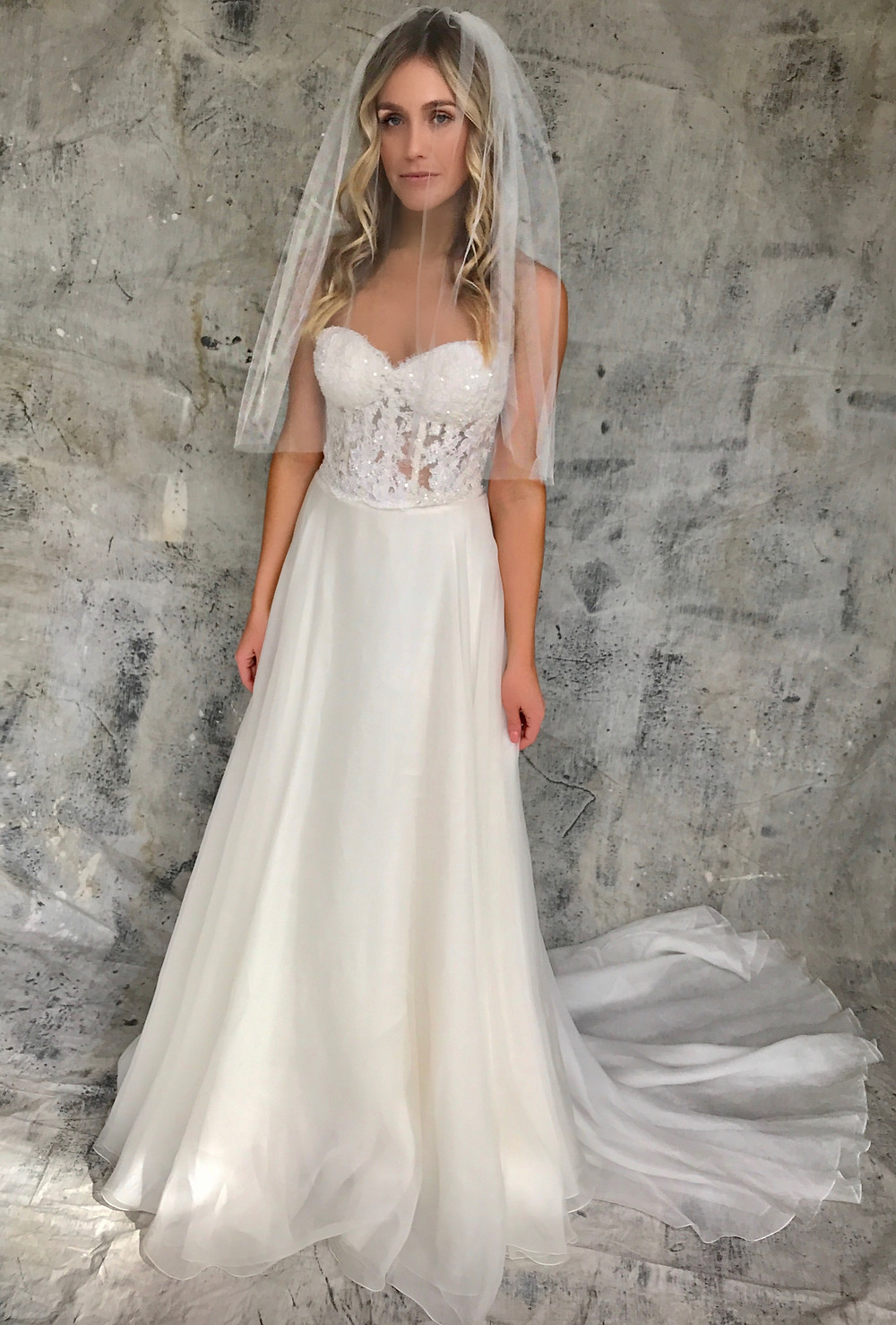 blushing bride wearing blusher veil