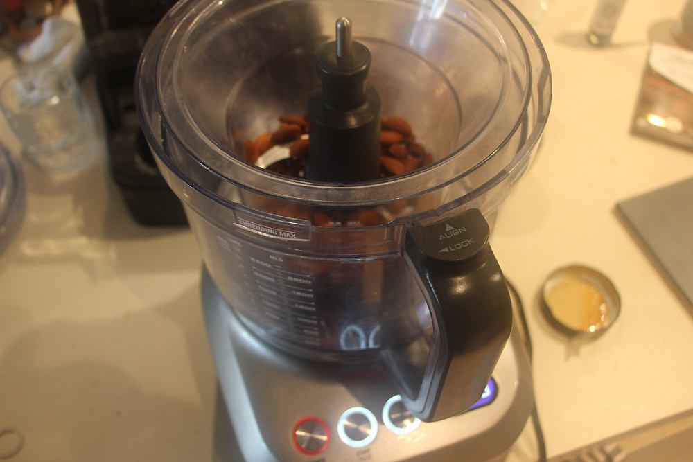 Coarsely grind the Almonds in a food processor and then  add to the mixture