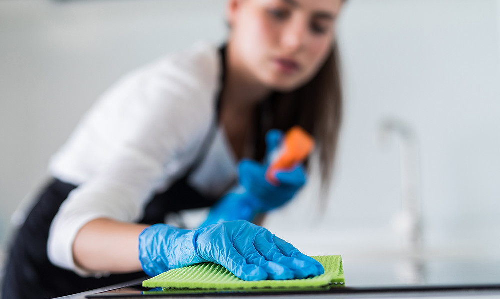 Cleaning and Disinfecting your Home while wearing nitrile gloves