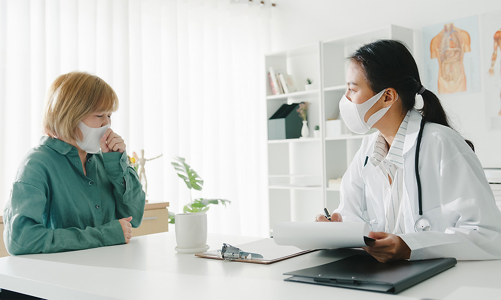 A Patient consulting a doctor about her illness