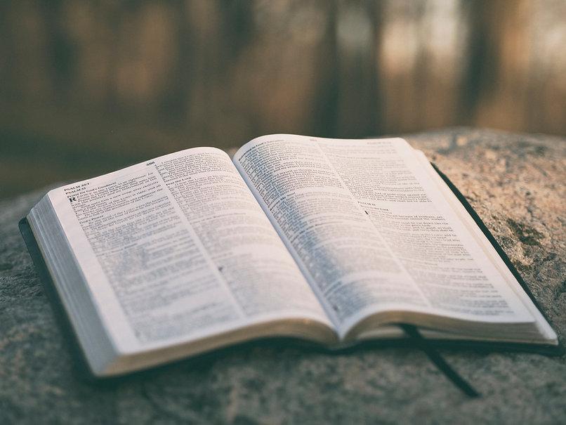 writing-rock-book-bible-book-page-close-