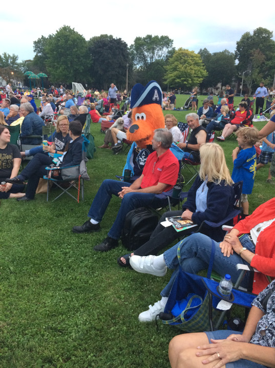 Concerts on the Green crowd with Mascot