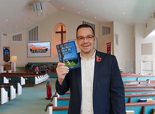 Darren Roy holding book