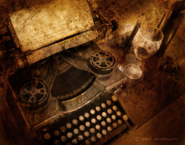 Old fashioned typewriter in sepia, with an almost epty glass of wine.  The image looks faded and distressed.