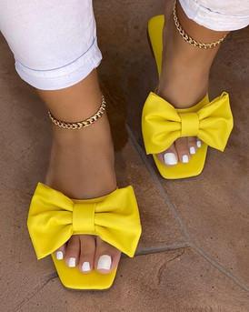 yellow bow slides.jfif