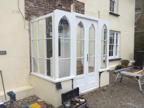 Gothic style porch installation