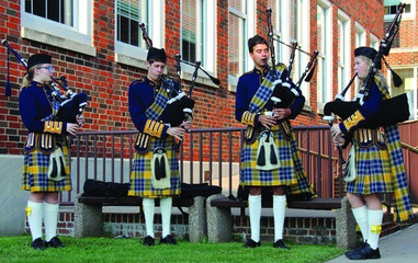 Student bagpipers outside HPHS.jpg