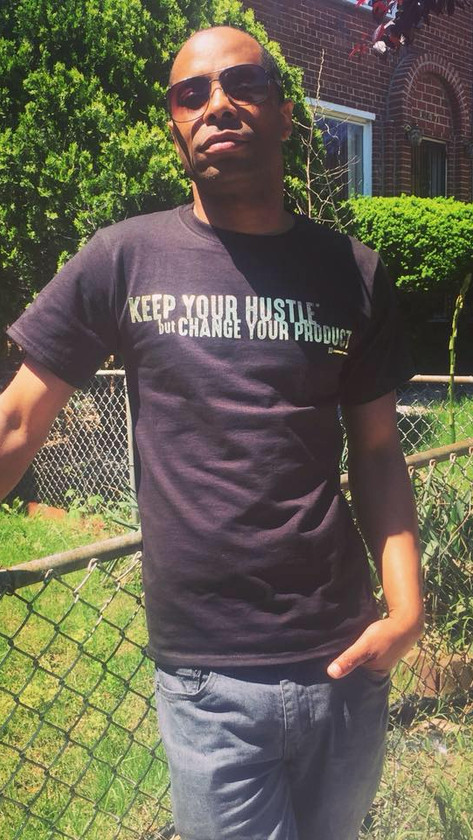 lamont in hustle shirt.jpg