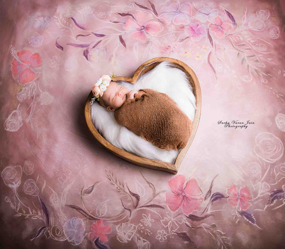 newborn photography chennai baby cute pose portrait heart bowl pink floral backdrop girl