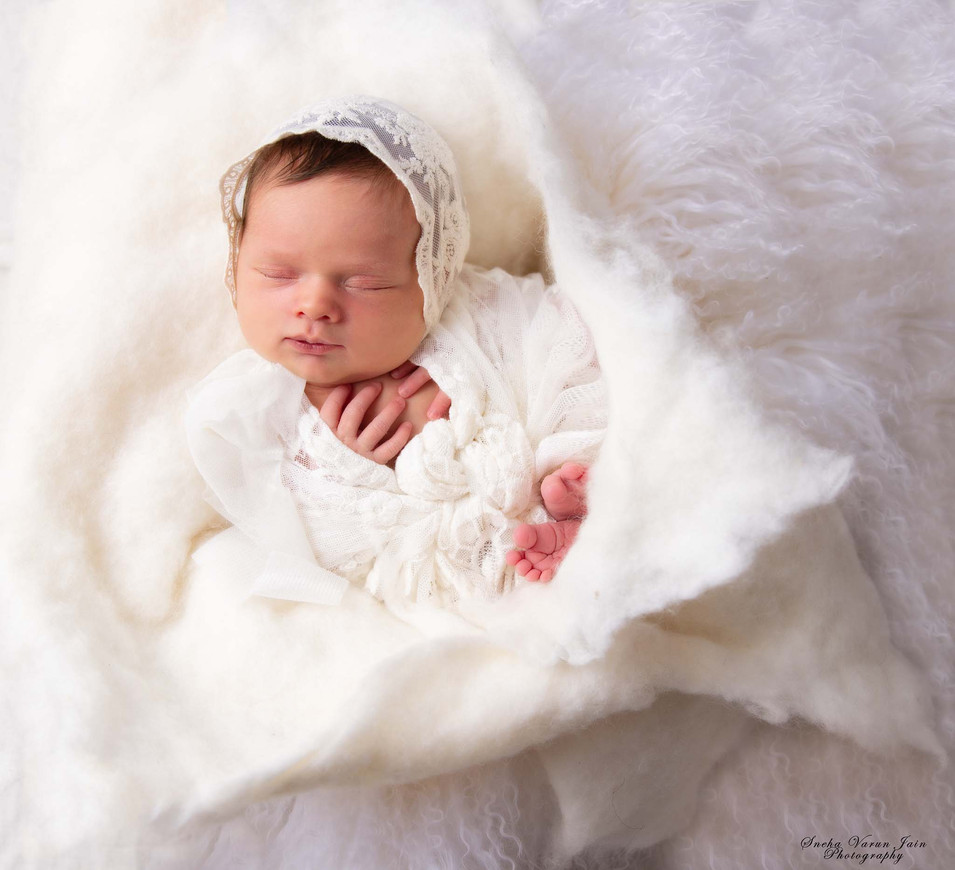 newborn photography chennai baby cute pose portrait white flower made of fluff