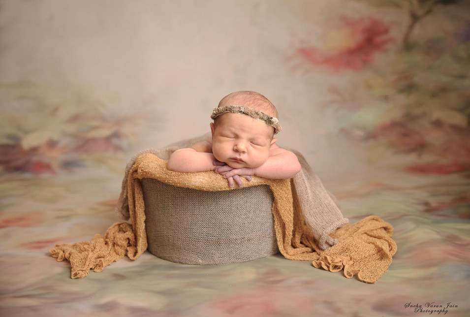 newborn photography chennai baby cute pose portrait bucket pose yellow intuition backdrop