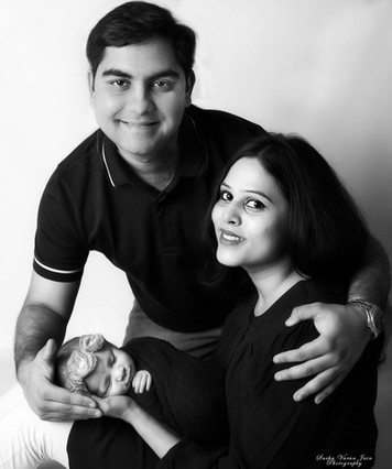 newborn photography chennai baby cute pose portrait parents happy black and white