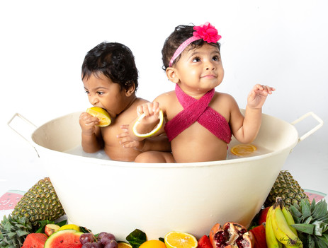 twin cake smash session ideas water milk bath fruit bath colourful kids photography one year old beautiful first birthday