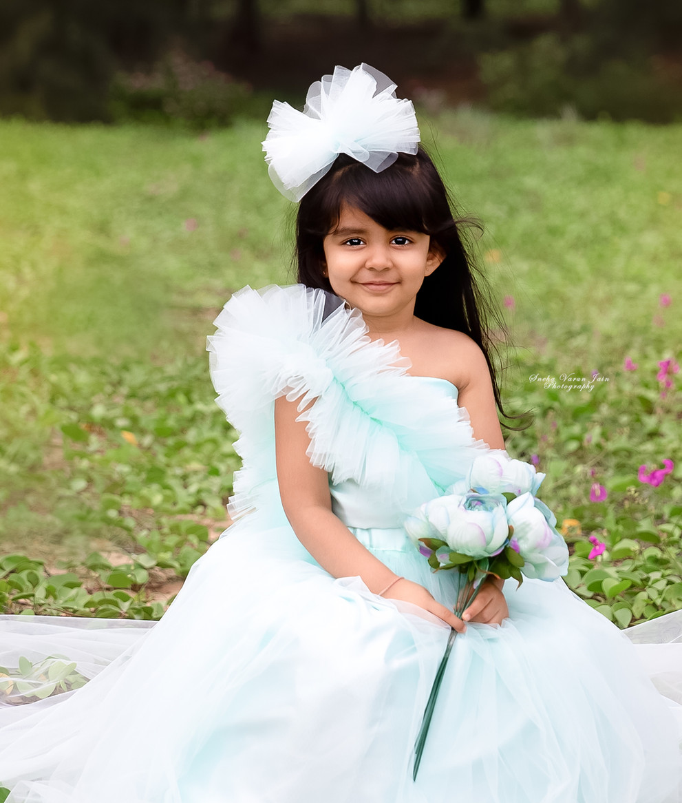 kids photography poses pastel green outdoor princess mini session love florals gown four year old toddler beach pastel green portrait