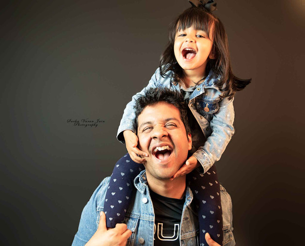 family photography pose dad father daughter laugh bond