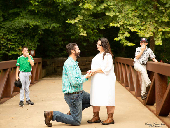 family photography poses outdoor engagement shoot love proposal couple