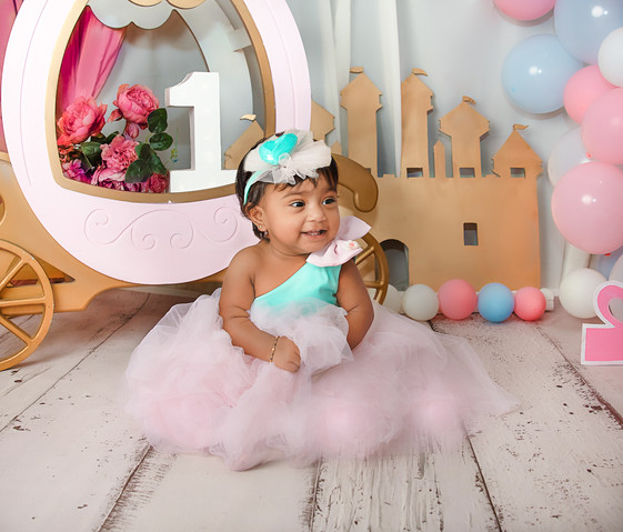 twin cake smash session ideas princess theme carriage balloons pink and white pastel kids photography one year old tutu dress beautiful first birthday twin baby girls twin sisters