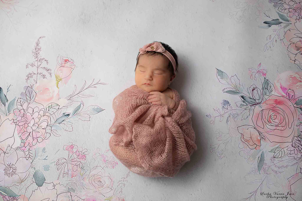 1 month old photography chennai baby cute pose portrait peach girl wrap