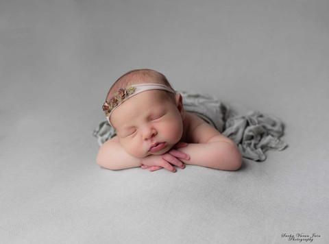 newborn photography chennai baby cute pose portrait green beanbag girl