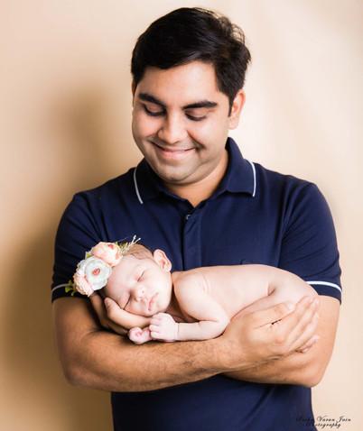 newborn photography chennai baby cute girl dad father love pose portrait peach