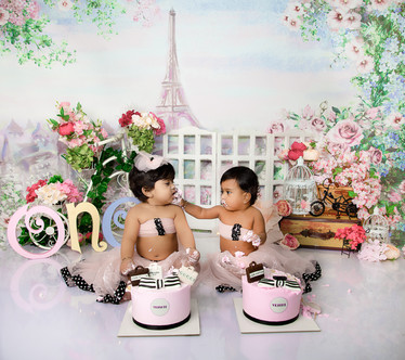 twin cake smash session ideas paris fashion theme eiffel tower cycle coffee shop pink and white pastel kids photography one year old tutu dress beautiful first birthday twin girls twin sisters