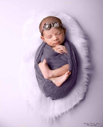 newborn photography chennai baby cute pose portrait lavender girl fur