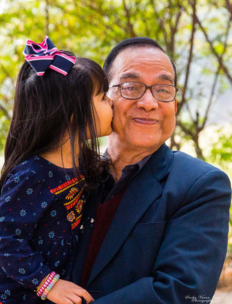family photography poses outdoor grandfather kiss toddler love happy