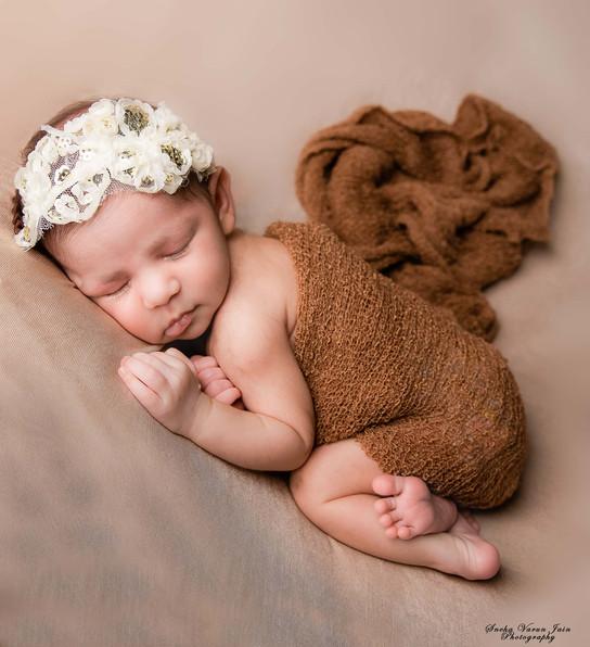 newborn photography chennai baby cute pose portrait brown beanbag bum up