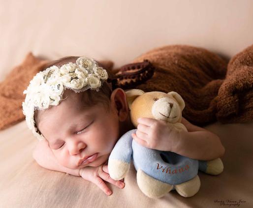 newborn photography chennai baby cute pose portrait beanbag brown teddy side
