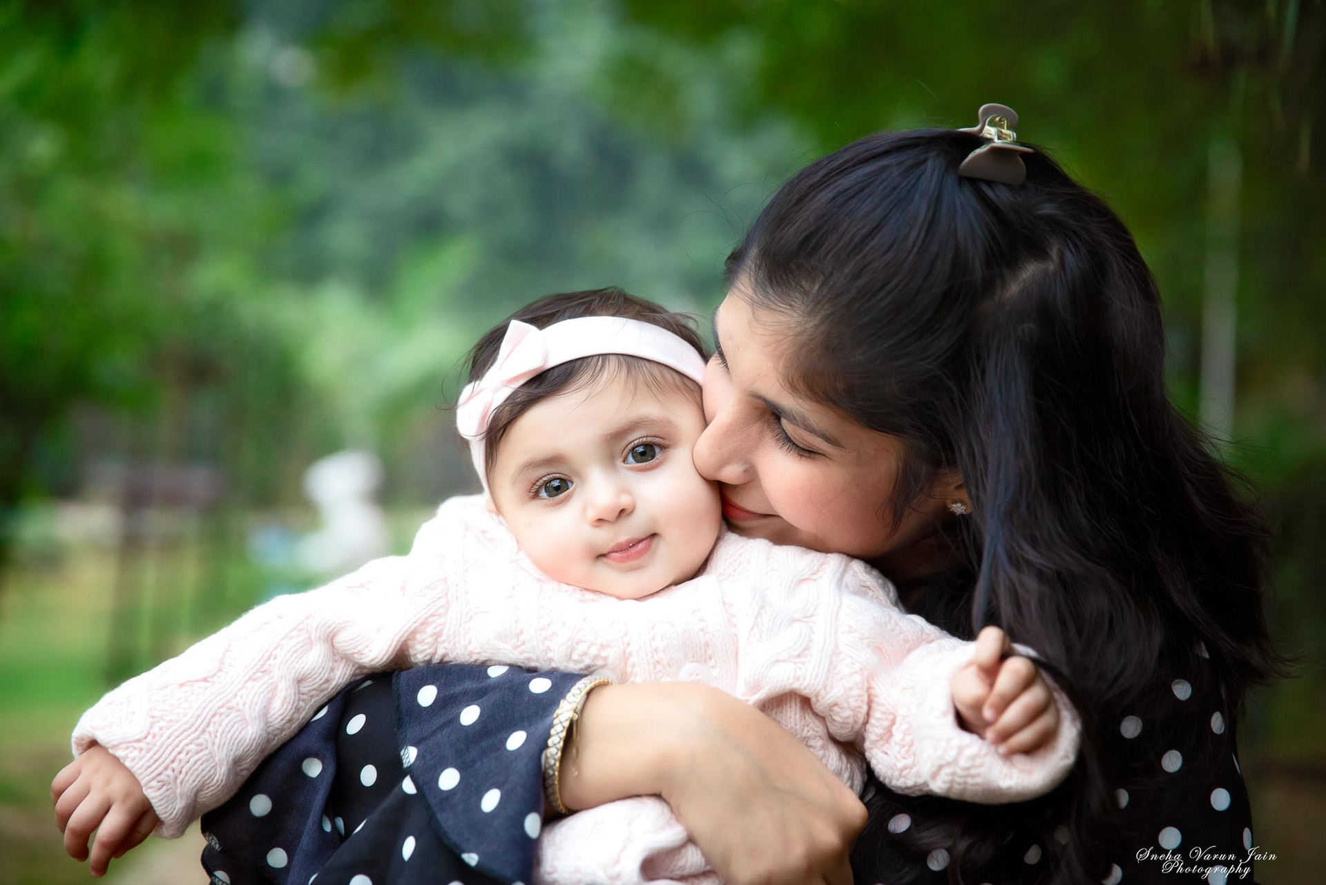 infant seven month baby photography chennai girl mother kiss love happy closeup