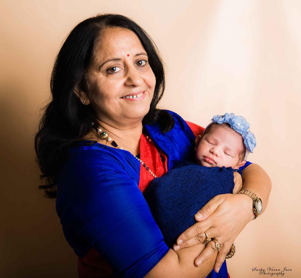 newborn photography chennai baby cute girl grandparent blue peach pose portrait
