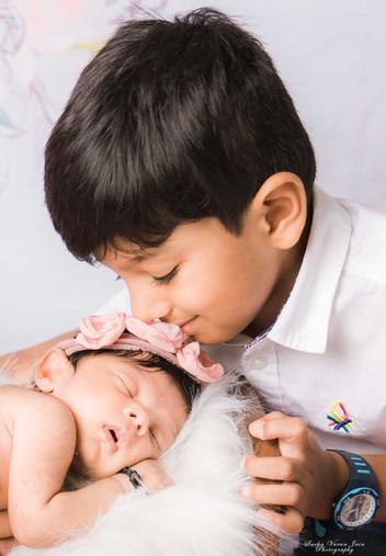 newborn photography chennai baby cute pose portrait sibling pink