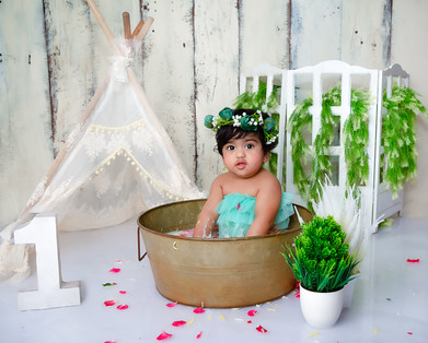 twin cake smash session ideas water milk bath floral flower bath green pastel kids photography one year old tutu dress beautiful first birthday