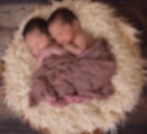 sleeping twins in basket.jpg