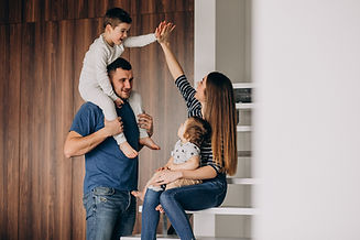 young-family-with-their-little-son-at-ho
