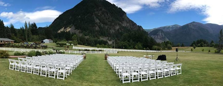 Mountain wedding in Portland Columbia River Gorge at Wind Mountain Ranch with wine barrels and white and green floral arrangement