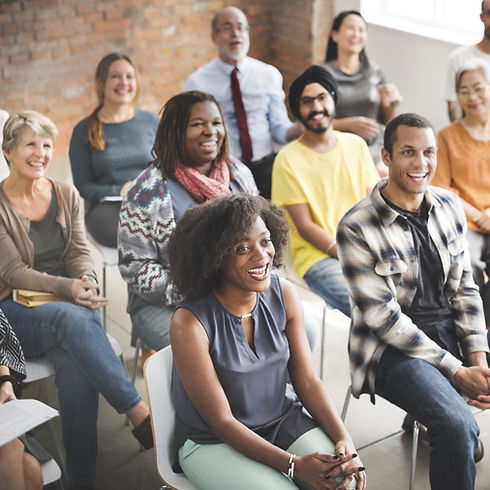 diverse group of smiling adults seated