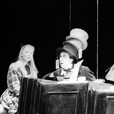 ALICE IN WONDERLAND by Carroll ; The Mad Hatter's Tea Party Scene ; Lesley Manville as Alice ; Christopher Good as Hare ; Michael Mears as Hatter ; Adapted by Wells, music by Davis ; Directed by Forrest ; Set Designed by Ward ; Lyric Theatre, Hammersmith, London, UK ; 18 December 1986 ; Credit: Conrad Blakemore