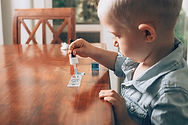 Little boy laboratory activity with colo