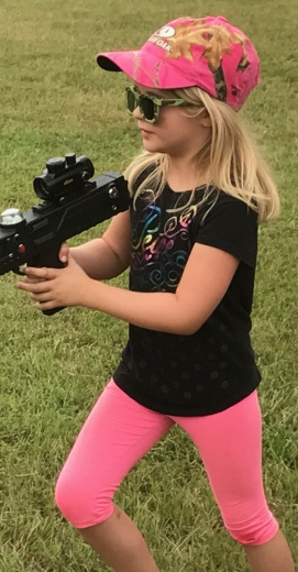little girl in pink laser tag
