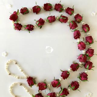 maroon rose bud