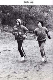 John Waller and, John Leung (both class of 1980) warm-up before a big race.