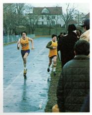 Shaun Kalba receives the baton from John Beale. (class of 1983)