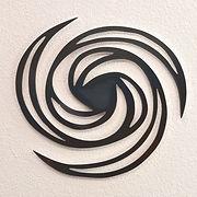Metal art titled Expansion based on geoglyph