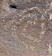 prehistoric rock art from Jornada Mogollon culture in NM, spiral shaped