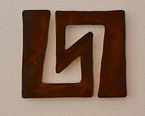 Rustic metal wall art based on ancient art in the form of petroglyphs - called Symmetry