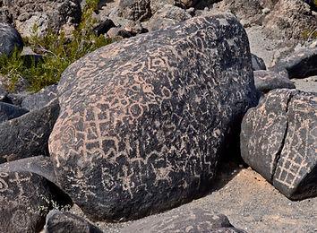 ancient petroglyph rock art on large rocks